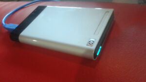 500 Gig mini HP pocket drive. with USB cable
