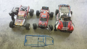 Four RC Electric racing cars/Dirt Bike
