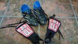 size one cleats and shin pads set