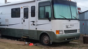 99 Class A with Washer/Dryer, Slide and Electric Awnings
