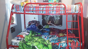 Red metal bunk bed with double on bottom