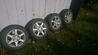 Four - Studded General Altimax Arctic Winter tires on Rims