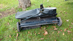 Tow behind lawn sweeper
