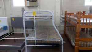 NEW single over double bunks with mattresses. $499 WOW!