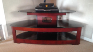 Glass TV stand, excellent condition.   50 inch wide 22 deep