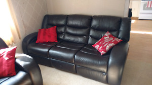 2 black leather reclining couches