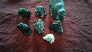 Hand crafted jade and soapstone bear carvings.
