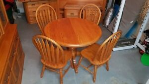 SOLD  ROUND OAK TABLE AND 4 CHAIRS