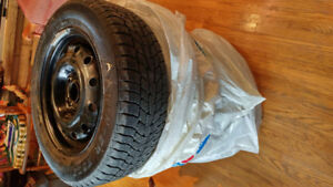 Snow tires on rims - set of four snow tires on rims for a Honda