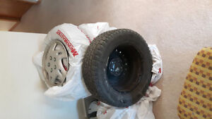 215/60r15 winters, on Chevrolet rims with hubcaps