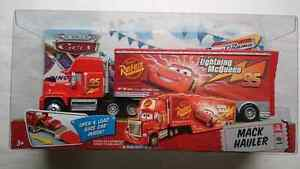 DISNEY PIXAR CARS MACK SEMI HAULER #1 RACE CAR INCLUDED 2009