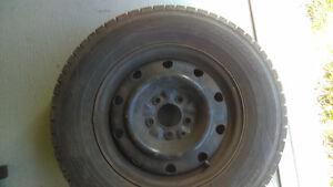 4 Pneus hiver Dunlop Graspic DS-3 avec rimes 215-70R15