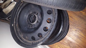 Selling 4 tires with snow rims 205/55/16r London Ontario image 4