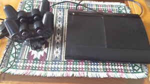 PS3 with 2 controllers and charger.