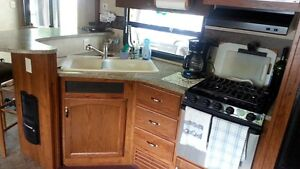 Retreat Park model Trailer with Sunroom & Pattio & Shed