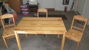 PINE TABLE AND THREE CHAIRS