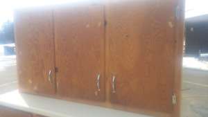 Plywood upper and lower cabinets with laminate countertop