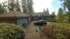 IMMACULATE CUSTOM DESIGNED HOME SITUATED IN A PRIVATE 2 ACRE LOT