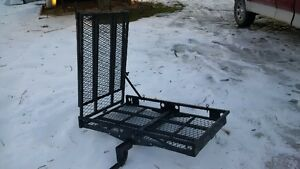 Hitch mounted cargo carrier with two piece foldimg ramp