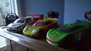 2 nitro and 1 electric rc car