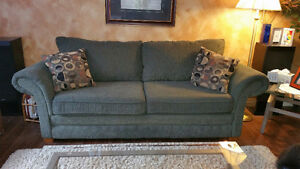 Forest green couch and loveseat.