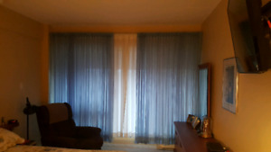 Sheer curtains with hardware