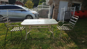 FREE Glass patio table and 2 chairs!
