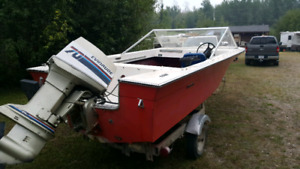 15 foot Grew with 70 HP Evinrude