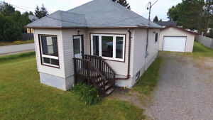 Updated Bungalow with 1.5 insulated on large lot.