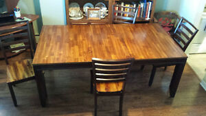Beautiful solid dining table and 4 chairs