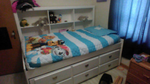 White twin captains bed with bookcase & storage