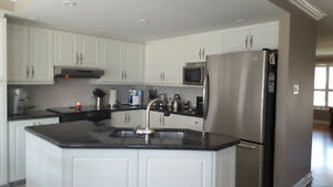 White Thermofoil Kitchen Cabinets & Granite Counter Tops