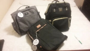 Diaper bags +graco uppa baby adapter +tub /stand car seat cover