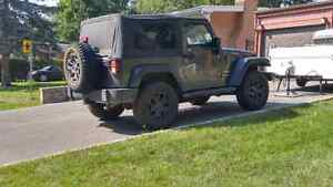 5x BF Goodrich KM Mud Terrain LT255/75R17 tires and Willy's rims West Island Greater Montréal image 5