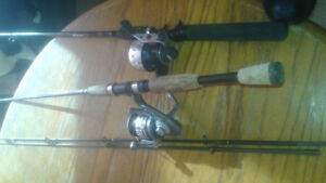 Two rods and reels and tackle.