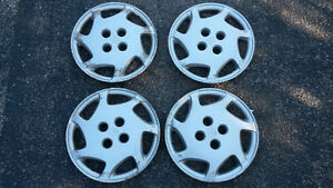 Four (4) 2002 Toyota Corolla hubcaps 185/65R14