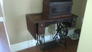 antique sewing machine and table.