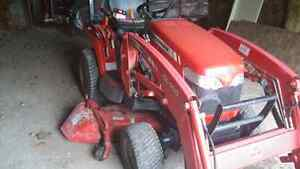 Compact tractor with loader blower and mid mount mower