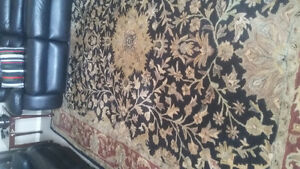 Beautiful black  large area rug130 OBO need gone ASAP!