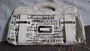 Cream coloured Guess purse/clutch