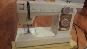 Janome model 344 sewing machine with travel case