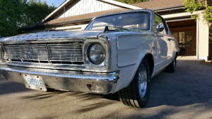 1966 Plymouth Valiant Signet. Great daily driver.