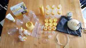 Medela swing breast pump, bottles and many accessories Kitchener / Waterloo Kitchener Area image 1