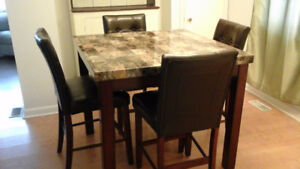 Bar style table and 4 chairs
