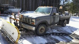 **1986 Ford F-250 Pickup Truck with Fisher Plow