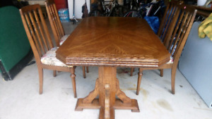 Table and four chairs and two extenders