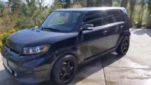 2012 Scion xB Black with extra rims and tires