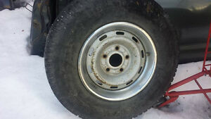 Tire with rim 245 75 r16
