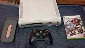 Xbox 360 with controller, hard drive and skate 3