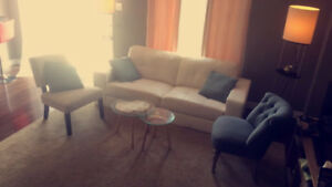 1 couche and 2 accent chairs, 2 glass tables for $400